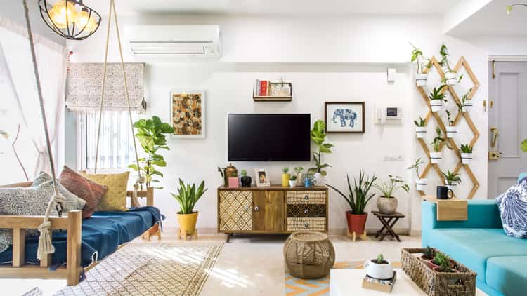 A living room with indoor flowers