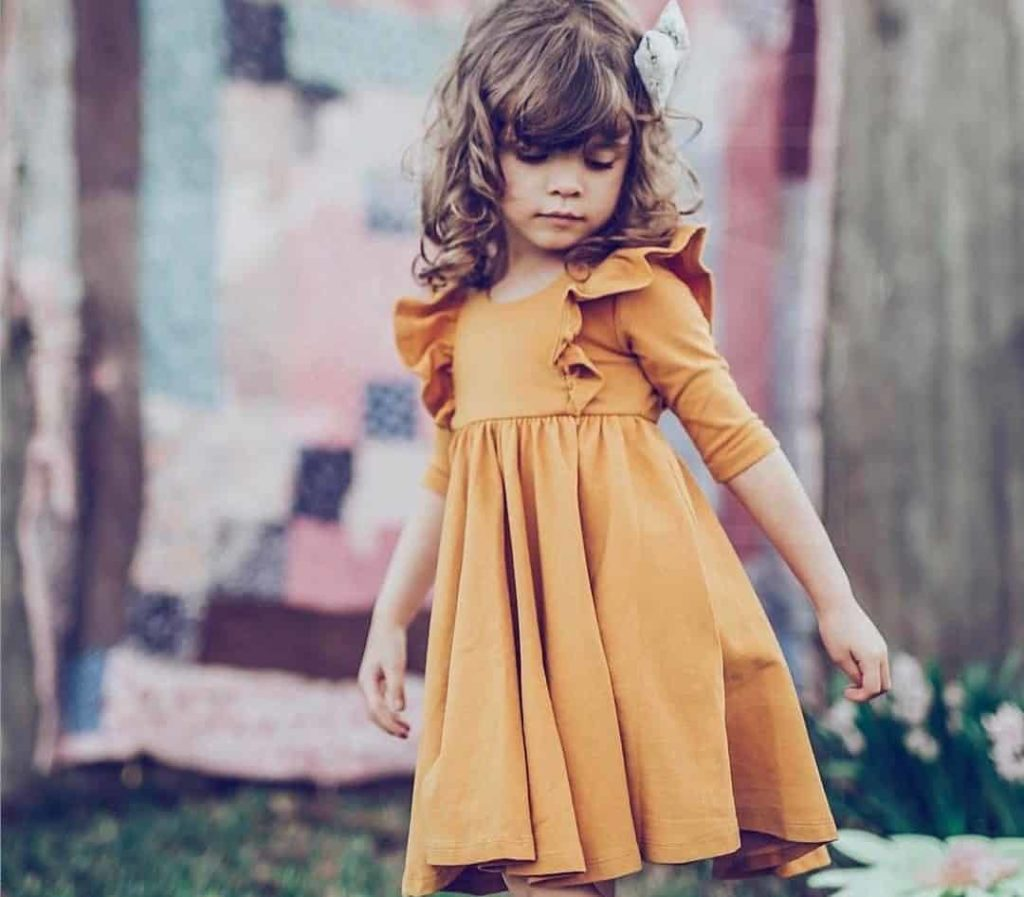 Little girl's clothes with patterns and shades